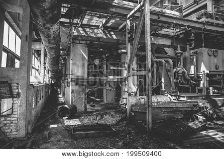 Abandoned factory interior inside, black and white photo