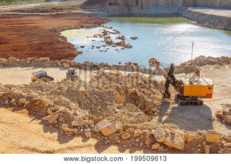 Quarry excavator heavy duty machine and other quarry equipment, view from above