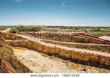 Quarry landscape. Sand, clay and stone extraction industrial minerals