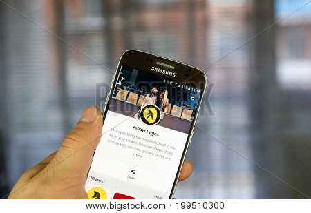 MONTREAL CANADA - JULY 14 2017 - Yellow Pages mobile application. Yellow pages refers to a telephone directory of businesses organized by category