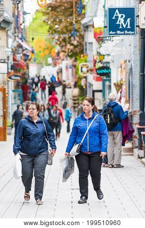 Quebec City Canada - May 30 2017: Lower old town street called Rue du Petit Champlain with tourist women shopping walking
