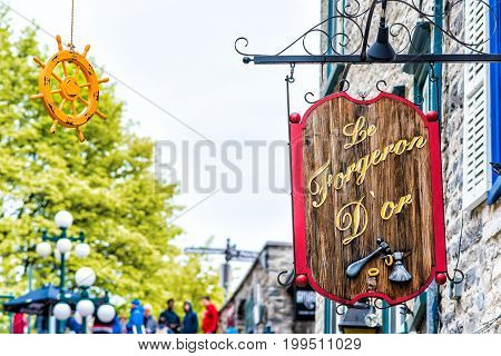 Quebec City Canada - May 30 2017: Lower old town street Rue du Petit Champlain with hanging decorations by restaurant