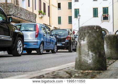 Arqua Petrarca, Italy - July, 27, 2017: car parking in Arqua Petrarca, Italy