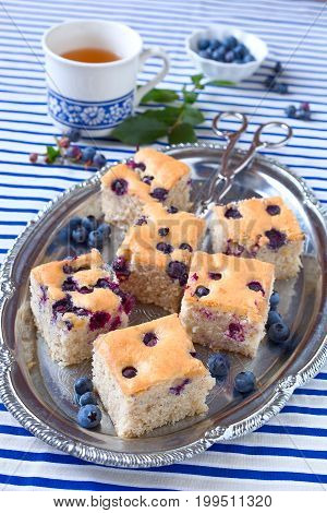 Pieces of simple, homemade blueberry cake on a plate.