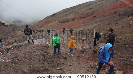 Parque Nacional Cotopaxi, Cotopaxi / Ecuador - August 11 2017: Tourists climbing the slope heading to the Jose Rivas refuge located at 4800 meters in the volcano Cotopaxi