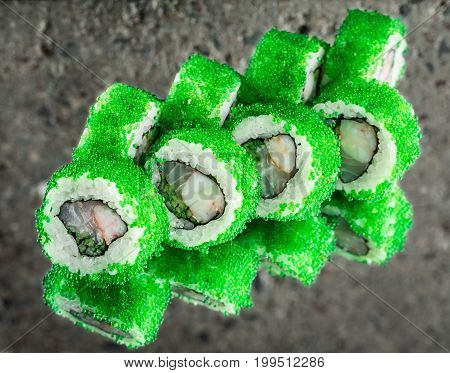 Roll Samurai made with flying fish roe over concrete background