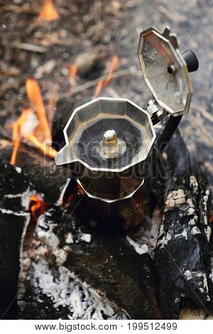 Camping trip. Kettle at the bonfire