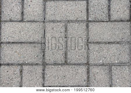 Gray texture background of paving slab close-up