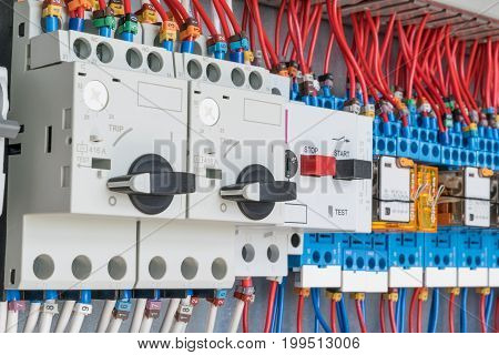 n the electrical control panel are circuit breakers protecting the motor and relay. Circuit breakers with rotary handles and push-button and arranged in a row. Wires with ferrules number coded.