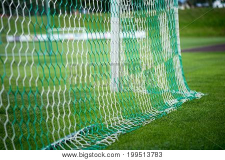 Part of green net on the football goal.