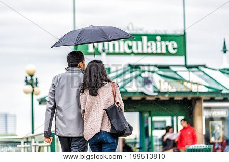 Quebec City, Canada - May 30, 2017: Closeup Of Couple Holding Umbrella Walking Toward Funiculaire In