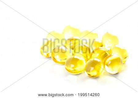 yellow gelatin pills on white background  poster