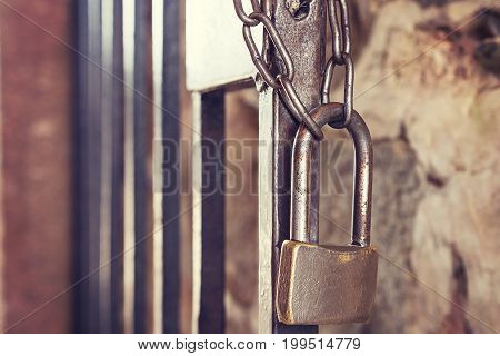 Old vintage lock with chain on iron gate. concept of reliability and safety. Old lock close-up. Close the lock
