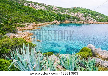 Sardinia costline with sandstone rocks and hidden bay with clear blue sea water. Italy.
