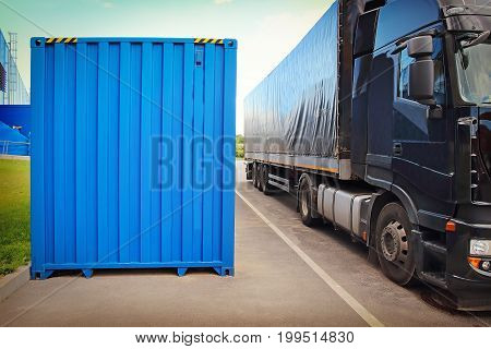 Truck and container in background of the logistics center