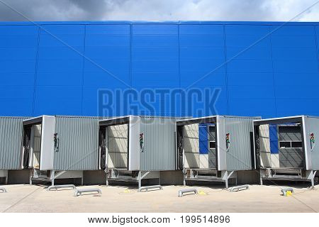 modern logistics center. Loading dock at a warehouse. Ramp of the logistic warehouse. Logistics background.