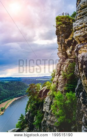 Viewpoint with some tourist on bastei rock formation in Saxon Switzerland National Park, Germany.