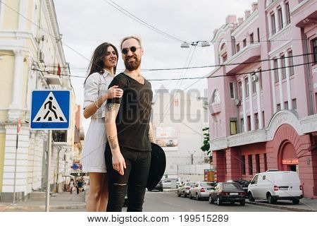 Man And Woman Or Young Couple Making A Trip As Tourists In City.
