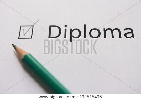 Complete training, get diploma. To fulfill set goal. word DIPLOME is written on white paper in gray pencil, marked with tick.