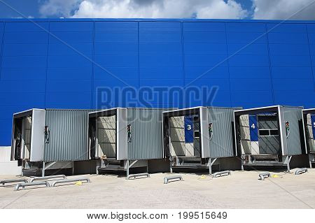 Loading dock at a warehouse. modern logistics center. Ramp of the logistic warehouse. Logistics background.