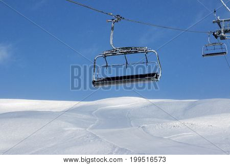 Ski Slope, Chair-lift On Ski Resort And Blue Sky With Falling Snow