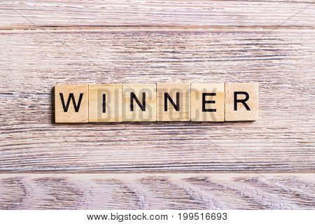 word winner on cubes on wooden background