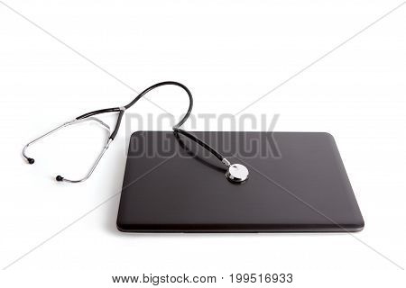 Laptop with stethoscope isolated on white background. Clipping path included.
