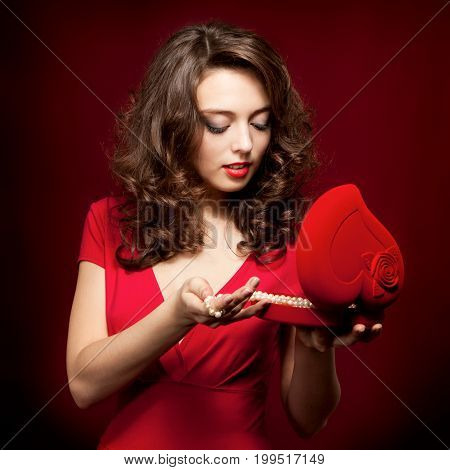 Happy Girl Opening A Gift On Valentine's Day