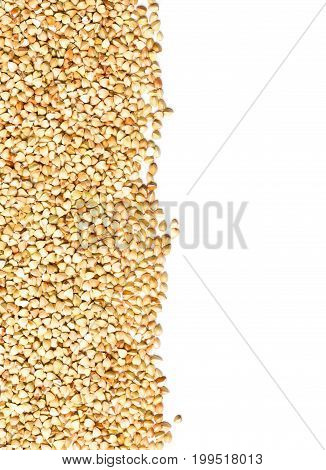 Raw natural uncooked buckwheat seed kernels border frame over white background