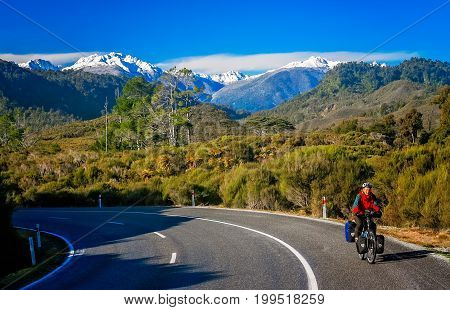 Woman on a cycle touring trip in New Zealand in winter