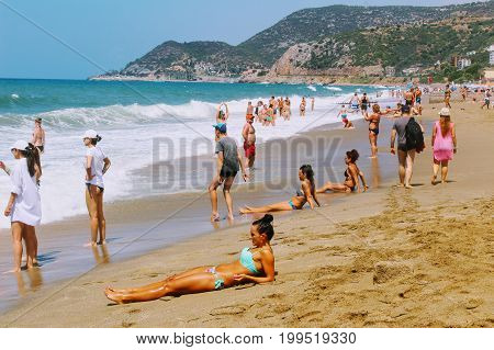 July, 2017 - Vacationers bathe in the sea and sunbathe in the sun on Cleopatra Beach (Alanya, Turkey).