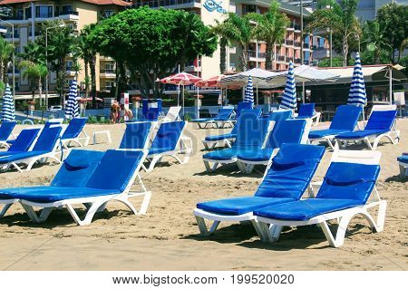 July, 2017 - Empty chaise lounges on Cleopatra Beach (Alanya, Turkey).