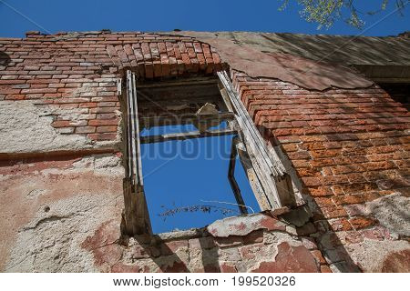 Abandoned red brick building no roof clear blue sky