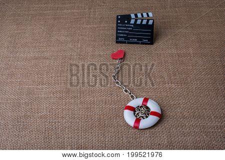 Life Preserver And A Cinema Clapper