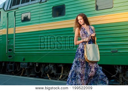 Woman Waiting Train On The Platform