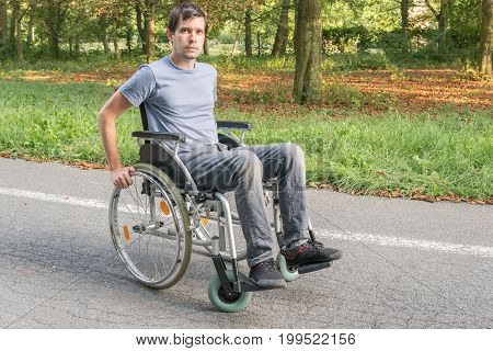 Young Handicapped Or Disabled Man On Wheelchair.