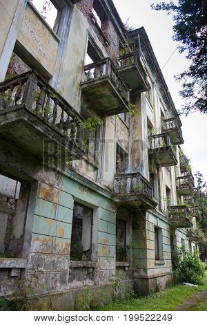 Abandoned mining ghost-town Tquarchal, Abkhazia. Ruined empty house destroyed by war.