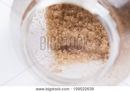 Close up view of brown sugar in a container.