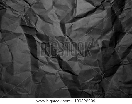 Black crumpled paper texture. Wrinkled Paper background