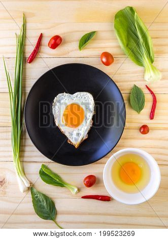 Flay Lay Vegetables, Herbs, Spices And Egg, Fried Egg  On Wood Background.