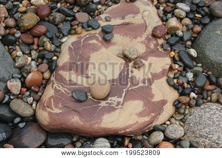 A large sandstone rock on a beach of Lake Superior.   Pictured Rocks National Lakeshore, Upper Peninsula of Michigan