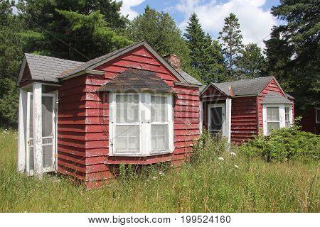 Small red run-down cabin in Upper Peninsula of Michigan