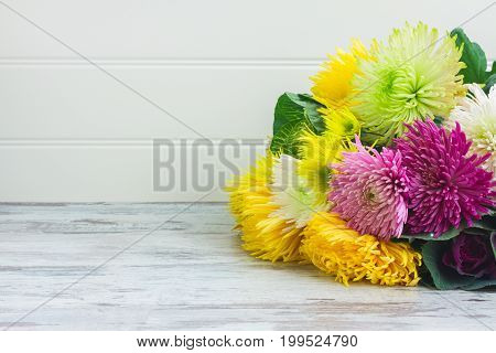 Chrisantemum fresh fall flowers bouquet on wooden aged table with copy space