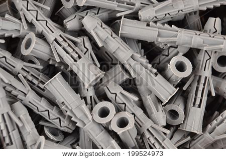 Some new gray plastic dowel close up