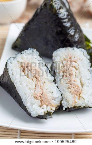 Korean triangle kimbap Samgak made with nori rice and tuna fish similar to Japanese rice ball onigiri. Vertical