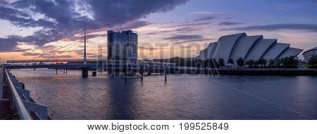 GLASGOW, SCOTLAND - JULY 21: The River Clyde with the Millennium Bridge and the SEC Armadillo on July 21, 2017 in Glasgow, Scotland. The Armidillo is Glasgow main conference space.