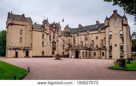 ABERDEENSHIRE, SCOTLAND: JULY 25: Fyvie Castle on July 25, 2017 in Aberdeenshire Scotland. Fyvie Castle is said to be the finest baronial castle in Scotland. It has five towers named after past owners