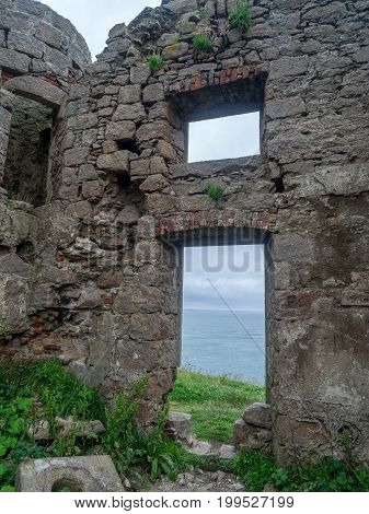 ABERDEENSHIRE, SCOTLAND: JULY 25: New Slains Castle on July 25, 2017 in Aberdeenshire Scotland. New Slains Castle is said to have inspired Bram Stoker to write Dracula.