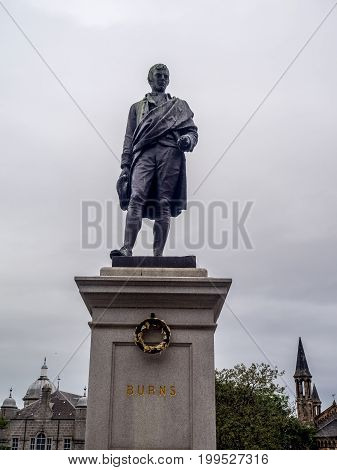 ABERDEEN, SCOTLAND: JULY 25:Statue of Robert Burns on July 25, 2017 in Aberdeen Scotland. Robbie Burns is one of Scotlands most famous poets and is still loved around the world.