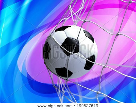 soccer ball in goal net on abstract background